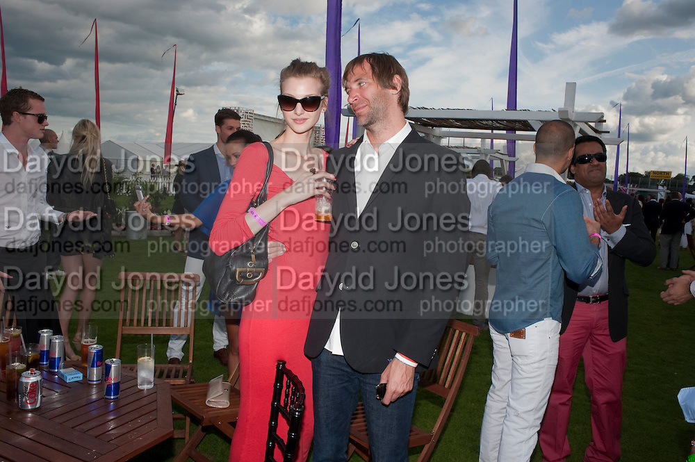 ANNETTE MULLER; PAUL HARRIS, After party at China White's club. Cartier International Day at Guard Polo Club, Windsor Great Park. 24 July 2011. ChinaWhite Tent during Cartier Polo. <br /> <br />  , -DO NOT ARCHIVE-© Copyright Photograph by Dafydd Jones. 248 Clapham Rd. London SW9 0PZ. Tel 0207 820 0771. www.dafjones.com.
