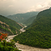 Flame tree and river bed on road to Wutai, Sandimen, Pingtung County, Taiwan