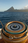 A gyrocompass, a non-magnetic compass, looks toward the Pitons on Saint Lucia.