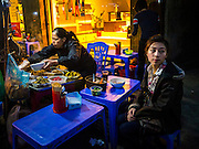 31 MARCH 2012 - HANOI, VIETNAM:   People at street side food stalls in the Old Quarter of Hanoi, Vietnam.    PHOTO BY JACK KURTZ
