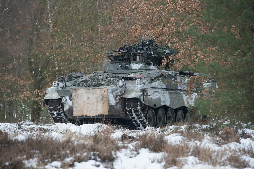23 FEB 2013, LETZLINGEN/GERMANY:<br /> Schuetzenpanzer, SPz, Marder 1A3, des Panzergrenadierbattailons 212 der Bundeswehr mit Wintertarnung waehrend einer Gefechtsuebung im Winter, Gefechtsuebungszentrum Heer, Truppenuebungsplatz Altmark<br /> IMAGE: 20130223-01-034<br /> KEYWORDS: Gefechtsübung, Schnee, Schützenpanzer, Gefechtsübungszentrum, Heer, Armee, Streikräfte, Militaer, Miltär, Streitkraefte, Panzer, Streitkräfte,