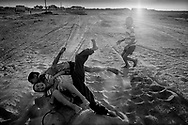 5/5: Kids playing by the shore of the Aral Sea  / Aralsk region, Kazakhstan