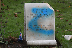 © Licensed to London News Pictures. 23/11/2015. London, UK. Blue spray paint is seen on a vandalised war grave at The Australian Military Cemetery next to St Mary's Parish Church in Harefield.  Photo credit: Peter Macdiarmid/LNP