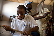 February 2008 - students at the  School for the Blind learn to work in Cotonou, Benin. The School takes 80 blind students surrounding villages and at no cost to their families teaches them geography, science, math and a work for the future. Though the school belongs to the state, it receives considerable funding from ONG.