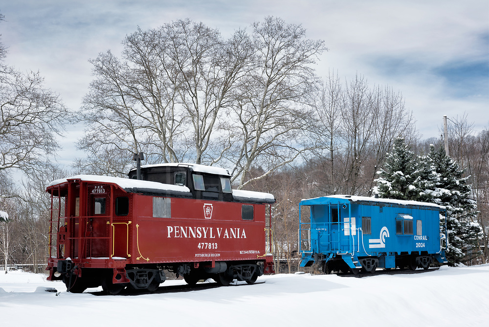 This old PRR caboose is on static display at Tyrone PA along with a more recent Conrail version in blue. It's a piece of Pennsylvania Railroad equipment classed as an N5B Cabin Car that was built in 1941 from their own design. Most N5's were built in the sprawling Altoona Shops or in nearby Hollidaysburg over the decades.<br />