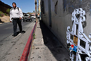 A cross along Calle Internacional in Nogales, Sonora, memorializes Mexican teenager, Jose Antonio Elena Rodriguez, 16, who was allegedly shot and killed by U.S. Border Patrol agents in Arizona who fired through the fence in to Mexico on October 10, 2012.  A witness in Mexico claims the youth was walking down the street.  The agents claim the the youth was throwing rocks at them across the border fence in to Nogales, Arizona, USA.