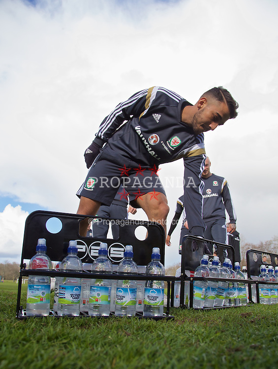 CARDIFF, WALES - Tuesday, March 24, 2015: Wales' Neil Taylor takes a drink during a training session at the Vale of Glamorgan ahead of the UEFA Euro 2016 qualifying Group B match against Israel. (Pic by David Rawcliffe/Propaganda)