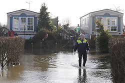 © Licensed to London News Pictures. 06/01/2014<br /> Yalding village Flood water starts receding again as a clear up operation starts.<br /> The village in Kent also gets a visit from the new Kent Police Chief Constable Alan Pughsley and Kent Police Commissioner Ann Barnes who walked around Little Venice Country Park meeting residents.  Alan Pughsley has been in the post since January 4th 2014.<br /> Photo credit :Grant Falvey/LNP