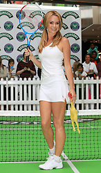 "©Licensed to London News Pictures. 07/06/2014. London, UK. ""Britain's Got Talent judge AMANDA HOLDEN takes on tennis on the Robinson pop and play tennis court at Westfield Stratford City. Photo credit: LNP"