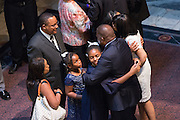 The wife and daughters of slain State Senator Clementa Pinckney embraces mourners during the public viewing in the Capitol June 24, 2015 in Columbia, South Carolina. Pinckney is one of the nine people killed in last weeks Charleston church massacre.