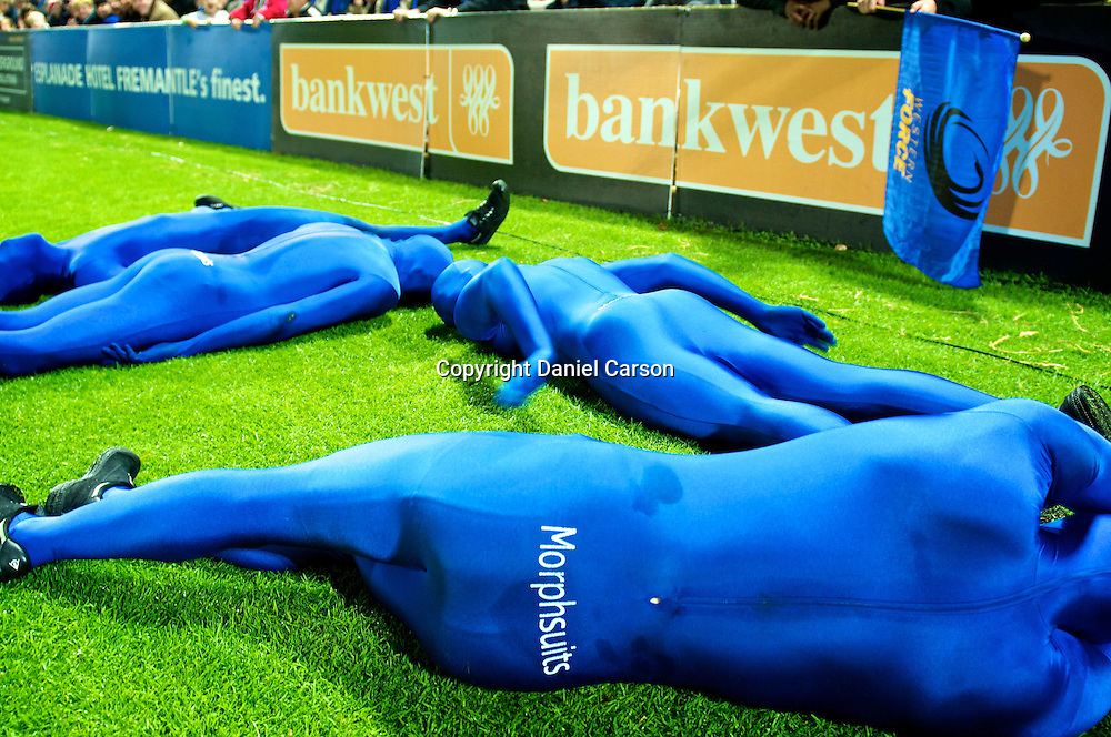"The Western Force Morphsuit Mascots ""plank"" during the match. Western Force v ACT Brumbies. Super 15 Rugby Match. Perth, Western Australia, nib Stadium. Saturday 21st May 2011. Photo: Daniel Carson