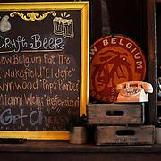 A framed chalkboard shows the names of different draft beers on the menu at Ms. Cheezious, a restaurant in Miami's MIMO district which specializes in grilled cheese sandwiches.  (photo by Lia Latty).