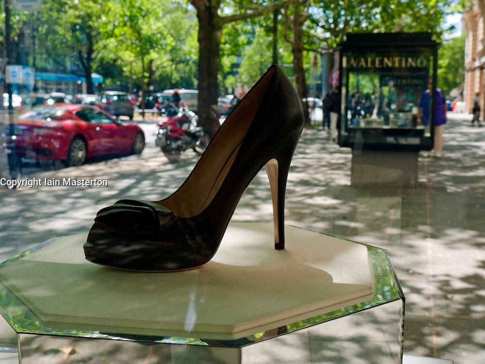 Elegant ladies shoe in glass display cabinet outside boutique on Kurfurstendamm or Kudamm in Charlottenburg in Berlin Germany