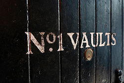 View of  warehouse door sign at Bowmore Distillery on island of Islay in Inner Hebrides of Scotland, UK