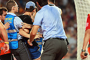 A pitch invader as arrested as Lionel Messi scores the second goal for Barcelona. Barcelona v Real Madrid, Supercopa first leg, Camp Nou, Barcelona, 23rd August 2012...Credit : Eoin Mundow/Cleva Media
