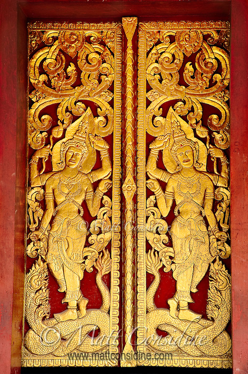 A beautiful golden relief against the dark red  background makes an immediate impression on the senses.<br /> (Photo by Matt Considine - Images of Asia Collection)