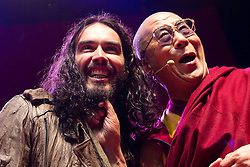 © Licensed to London News Pictures. 16/06/2012. Manchester , UK . Russell Brand introduces The Dalai Lama at the Manchester Arena , Greater Manchester , at the Stand Up and Be the Change youth event . The Dalai Lama strokes and pulls on Russell Brand's beard . The Dalai Lama is on a 10 day tour of the UK . Photo credit : Joel Goodman/LNP