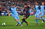 July 13 2017: Arsenal player Cohen Bramall (40) gets the ball past Sydney FC defender Sebastian RYALL (22) at the International soccer match between English Premier League giants Arsenal and A-League premiers Sydney FC at ANZ Stadium in Sydney.
