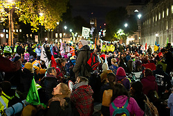 © Licensed to London News Pictures. 09/10/2019. London, UK. Extinction Rebellion activists stage a sit down protest in Whitehall. Police continue to attempt to clear roads in Westminster on the third day of the protest.  Photo credit: George Cracknell Wright/LNP