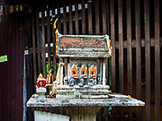 16 MAY 2017 - BANGKOK, THAILAND: A Spirit House in front of a home in Pom Mahakan. Spirit houses are traditionally built near homes and buildings in Thailand for the spirits of the property. The final evictions of the remaining families in Pom Mahakan, a slum community in a 19th century fort in Bangkok, have started. City officials are moving the residents out of the fort. NGOs and historic preservation organizations protested the city's action but city officials did not relent and started evicting the remaining families in early March.            PHOTO BY JACK KURTZ