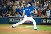 21 October 2015: Toronto Blue Jays pitcher Roberto Osuna (54) pitches in the ninth inning of game 5 of ALCS against Kansas City Royals at Rogers Centre Toronto ON Canada. Jays beat Royals  7 - 1. (Photo by Peter Llewellyn/Icon Sportswire)