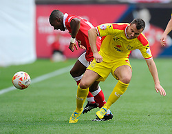 Bristol City's Kieran Agard battles for the ball with Milton Keynes Dons' Antony Kay  - Photo mandatory by-line: Joe Meredith/JMP - Mobile: 07966 386802 - 27/09/2014 - SPORT - Football - Bristol - Ashton Gate - Bristol City v MK Dons - Sky Bet League One