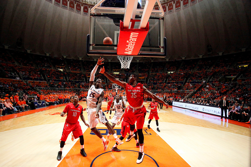 Illinois guard Kendrick Nunn (25) shoots against Rutgers forward/center Greg Lewis (35) during an NCAA college basketball game at the State Farm Center Tuesday, Feb. 3, 2015, on the University of Illinois campus in Champaign, Ill. Illinois won the game 66-54. (For the Herald & Review/ Stephen Haas)