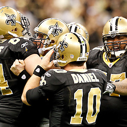 December 26, 2011; New Orleans, LA, USA; New Orleans Saints quarterback Drew Brees (9) celebrates after breaking the NFL single-season passing record formerly held by Miami Dolphins quarterback Dan Marino on a 9-yard touchdown throw to Darren Sproles during the fourth quarter of a game against the Atlanta Falcons at the Mercedes-Benz Superdome. The Saints defeated the Falcons 45-16. Mandatory Credit: Derick E. Hingle-US PRESSWIRE
