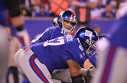 Dec 4, 2011; East Rutherford, NJ, USA; New York Giants quarterback Eli Manning (10) looks down the offensive line during the first half of their game against the Green Bay Packers at MetLife Stadium.