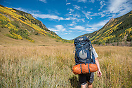 Backpacking on the Conundrum Trail in the Maroon Bells-Snowmass Wilderness near Aspen, Colorado.