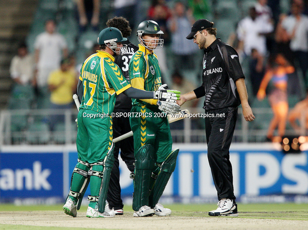 Daniel Vettori congratulates AB de Velliers and J Botha on the South African victory. South Africa v New Zealand. International cricket Pro20 match held at the the Wanderers Stadium, Johannesburg, South Africa. Friday 23 November 2007. Photo: Barry Aldworth/SPORTZPICS/PHOTOSPORT