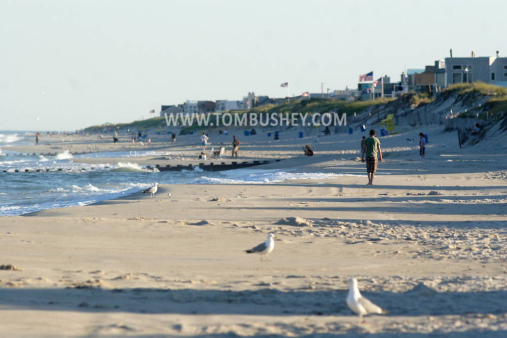 Beach Haven, NJ - A man walks along the beach in the late afternoon at Long Beach Island on July 11, 2007.