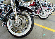 Road King motorcycles parked for the final Harley-Davidson party in downtown Milwaukee August 31, 2003.  The legendary American motorcycle company celebrated its 100th anniversary over four days.       REUTERS/Rick Wilking