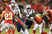 Jan 20, 2019; Kansas City, MO, USA; New England Patriots running back Sony Michel (26) runs with the football during the AFC Championship game at Arrowhead Stadium. The Patriots defeated the Chiefs 37-31 in overtime to advance to their fifth Super Bowl in eight seasons. (Robin Alam/Image of Sport)