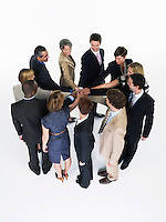 Group of Businesspeople in a circle joining hands