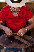 Traditional hand rolling cigars in Puerto Rico