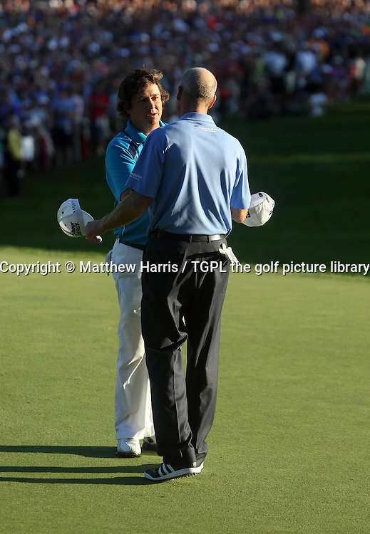 Jason DUFNER (USA) shakes hands with Jim FURYK (USA) having won his first major during fourth round US PGA Championship 2013,Oak Hill CC,