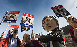 "Westminster, London, March 13th 2017. An effigy of Theresa May and protesters with their mouths taped shut demonstrate outside Parliament against what they claim is a gag by British Prime Minister Theresa May ""whipping MPs to endorse a 'blank cheque Brexit', as MPs vote on the Lords amendment of Article 50."""