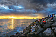 Oceania; Australia; Australian; Down Under; Victoria, Melborne, St. Kilda, people watching sunset at pier (m)