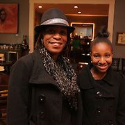 Evelyn Bryant, left, and May Bryant, 12, pose for a picture Sunday December 21, 2014 during the Brooklyn Arts District Christmas party at Canape in Wilmington, N.C. (Jason A. Frizzelle)