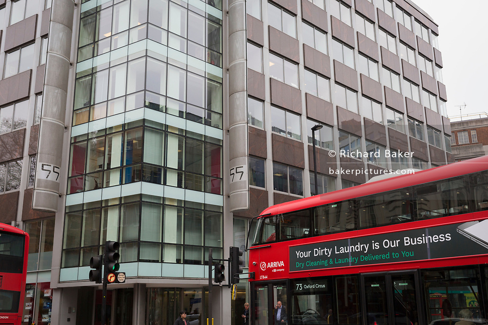 The day after Facebook's Mark Zuckerberg faced Senate Committee questions in Washington, a London bus with an ad for dirty washing drives past the offices of Cambridge Analytica on New Oxford Street, the UK tech company accused of harvesting the personal details of Facebook users (including Zuckerberg himself) in its data privacy scandal, on 11th April, 2018, in London, England.