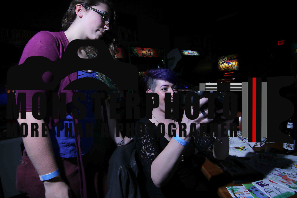 Bar patrons Sabrina Reissman and Leah Kalmbacher seen reviewing images on a canon camera at Rock Around the Block showcase Saturday, Jan 17, 2015 at Oddity Bar in Wilmington, Del.