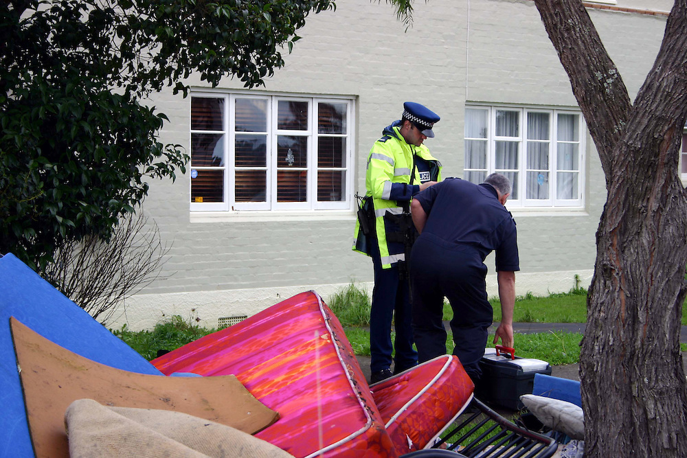 Police at the scene after a man was shot in the head with a rifle in Kupe Street, Orakei, a man has since been arrested, Auckland, New Zealand, Sunday, June 23, 2013. Credit:SNPA / Grahame Clark