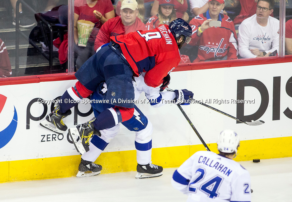 WASHINGTON, DC - MAY 21: Washington Capitals left wing Alex Ovechkin (8) crashes into Tampa Bay Lightning defenseman Anton Stralman (6) along the boards in the second period during game 6 of the NHL Eastern Conference  Finals between the Washington Capitals and the Tampa Bay Lightning, on May 21, 2018, at Capital One Arena, in Washington D.C.<br /> (Photo by Tony Quinn/Icon Sportswire)
