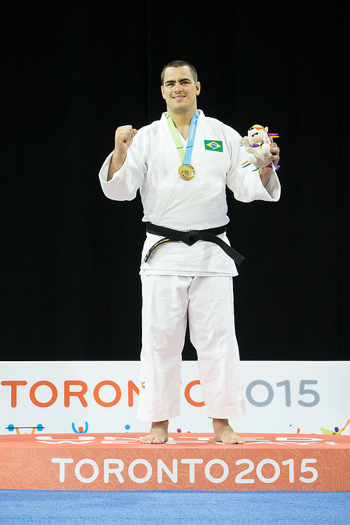 Gold medalist David Moura of Brazil celebrates during the medal ceremony for the men's judo +100kg class at the 2015 Pan American Games in Toronto, Canada, July 14,  2015.  AFP PHOTO/GEOFF ROBINS