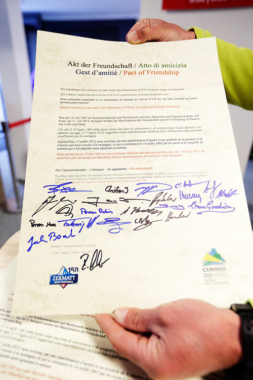 Pact of friendship signed by British, Swiss, Italian and French alpinists on the eve of the 150th ascension of Matterhorn, marking the second date of 150th anniversary.<br />