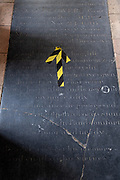 Social distancing hazard tape is on historical  flagstones in the nave of St. Michael's C of E church, during the Coronavirus pandemic, on 13th August 2020, in Beccles, Suffolk, England.