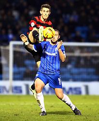 Peterborough United's Shaun Brisley battles with Gillingham's Danny Kedwell - Photo mandatory by-line: Joe Dent/JMP - Tel: Mobile: 07966 386802 14/12/2013 - SPORT - Football - Gillingham - Priestfield Stadium - Gillingham v Peterborough United - Sky Bet League One