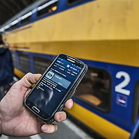 Nederland, Amsterdam, 13 april 2016<br /> Energiebesparingsapp van de NS speciaal ontworpen voor de machinist.<br /> Energy saving App for smartphones for train drivers working at the NS designed to drive as energy efficient as possible. <br /> <br /> Foto: Jean-Pierre Jans