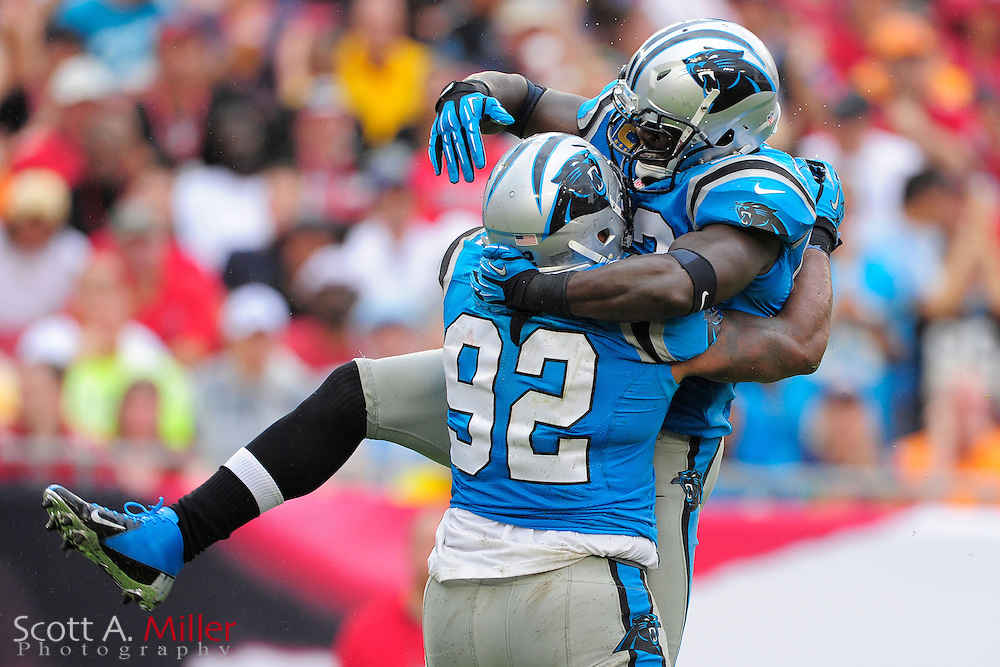 Carolina Panthers linebacker Jon Beason (52) and defensive tackle Dwan Edwards (92) cleebrate a defenive pay during the Panthers 16-10 loss to the Tampa Bay Buccaneers at Raymond James Stadium  on September 9, 2012 in Tampa, Florida. ..©2012 Scott A. Miller...